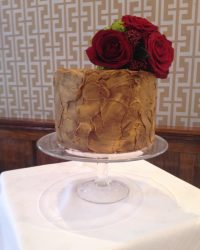 vintage bronze buttercream with fresh flowers.