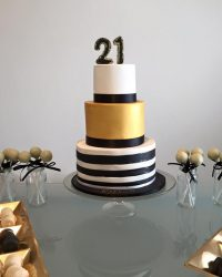 Black, white & gold stripped dessert table.