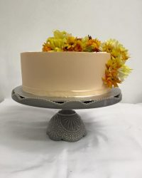 Peach buttercream with fresh flowers.