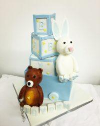 toy cart with bricks, sugar teddy bear & rabbit.